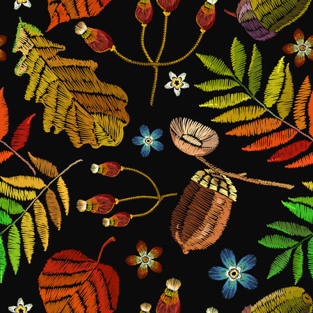Embroidery autumn seamless pattern. Classical september embroidery autumn leaves, butterfly, acorns wild forest, oak and maple leaves. Fashionable template for design of clothes, t-shirt design