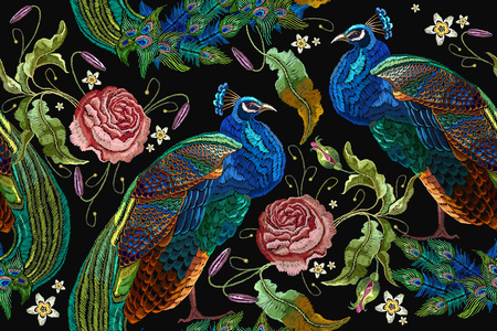 Embroidery peacocks and flowers peonies seamless pattern. Classical fashionable embroidery beautiful peacocks.