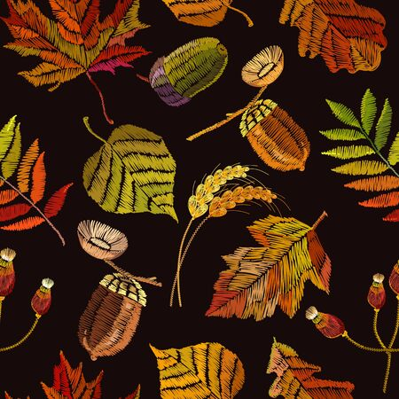 Embroidery autumn seamless pattern. Fashionable template for design of clothes, t-shirt design. Classical september embroidery autumn leaves, acorns wild forest, oak and maple leaves