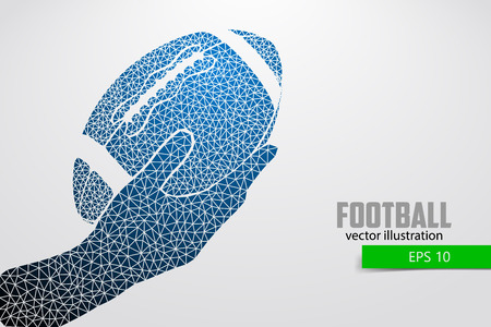 Hand holds the rugby ball, silhouette. Rugby. American football