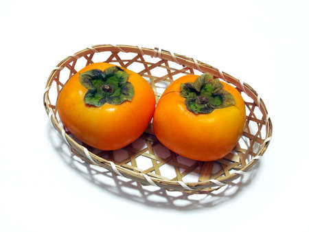 Photo of fruits Persimmons in a basket