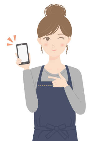 A woman in an apron with a smartphone