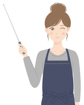 A woman in an apron explaining with a pointer
