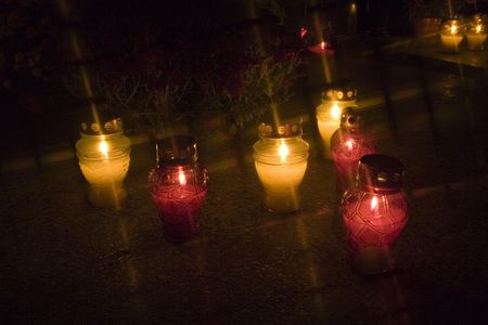 all saints  day: Candels on a cementary at night in All Saints Day in Poland