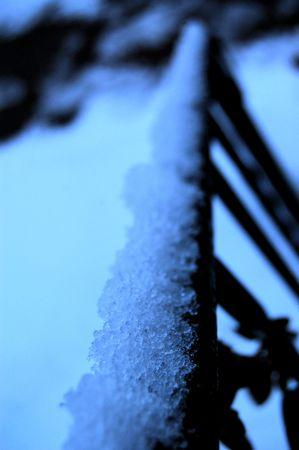Snow on railing