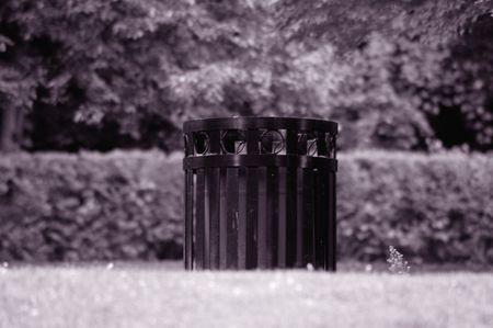 Garbage can in park, vintage look. Banco de Imagens