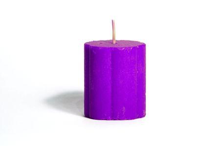 Purple candle on white background Banco de Imagens