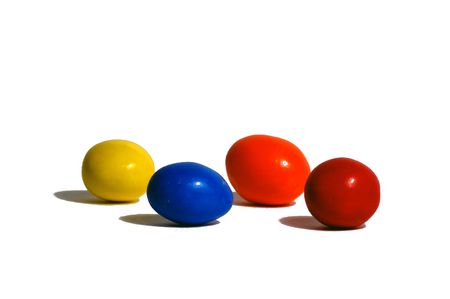 Round colored candies on white background