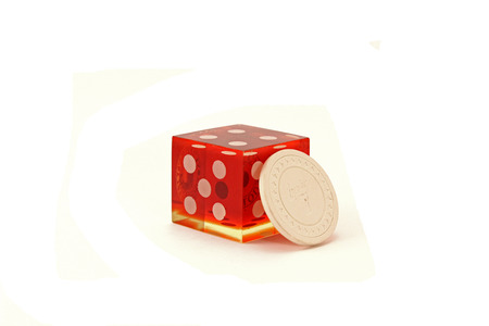 Large Casino Die with Poker Chip  Banco de Imagens
