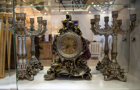 Vintage clock style showed on showcase behind glass in Vietnam
