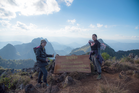 Tourist on top of mountain with message Peak of Doi Laung Chiangdao, The height of 225 meters above sea level