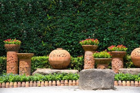 flowerpots: Little tree garden in clay pots on green tree background