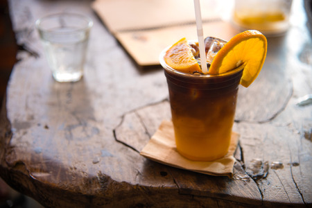 Colombia ice coffee mixed with orange juice on topping a piece of fresh orange
