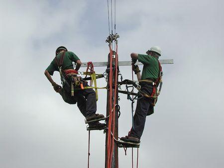 energy work: Power lineman working on a pole