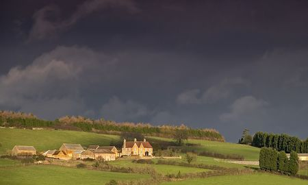 acres: An English country farm taken with a storm approaching