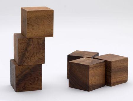 erect: Brown wooden building blocks