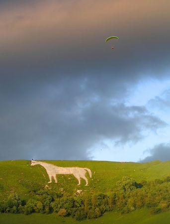 paragliding: A Para glider and Westbury White Horse in Wiltshire England Stock Photo