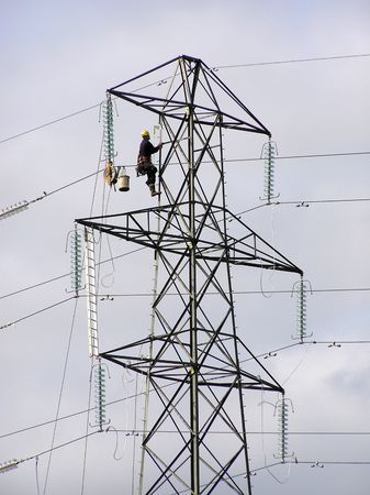 lineman: Power lineman climbing electricity pylon Stock Photo