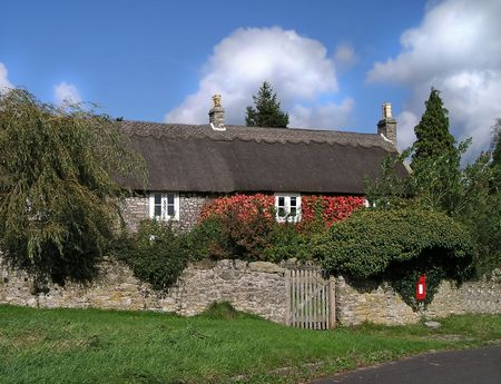Thatched cottage in England photo