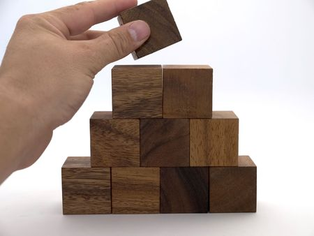 exclusion: Wooden building blocks in the shape of a triangle