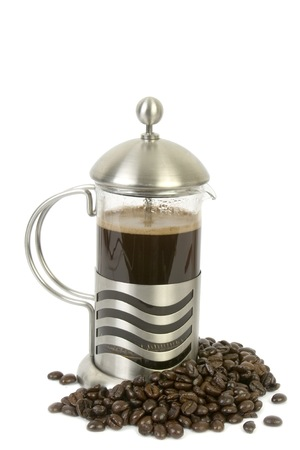 French press isolated on white with coffee beans underneath