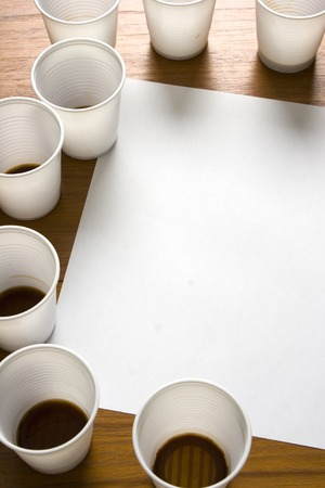 uninspired: Space for copy, blank paper around coffee cups. Stock Photo