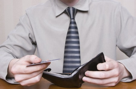 over paying: paying with a credit card over a desk