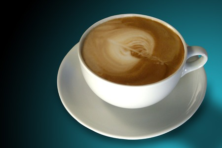 cappuchino: Cappuchino with blue background Stock Photo