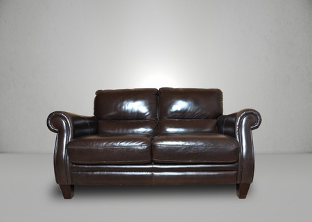 sofa: Room, leather sofa in a grey room