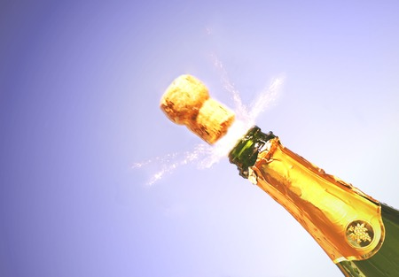champagne pop: Champagne bottle exploding Stock Photo