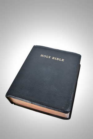 Closed bible, with spotlight effect on background