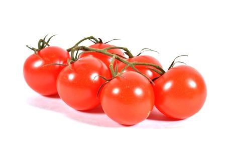 heathy diet: Vine tomatos isolated on white with slight shadow.