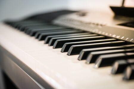 Piano, keyboard keys shot across the piano keys Foto de archivo