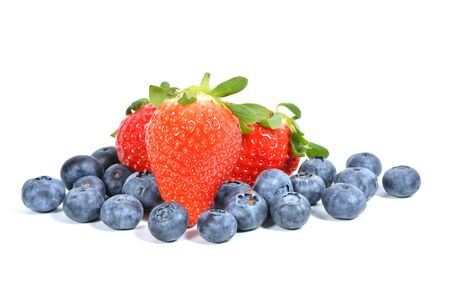 Strawberries and blueberries isolated over white. Berry mix
