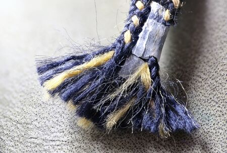 old boot lace. frayed old boot lace.