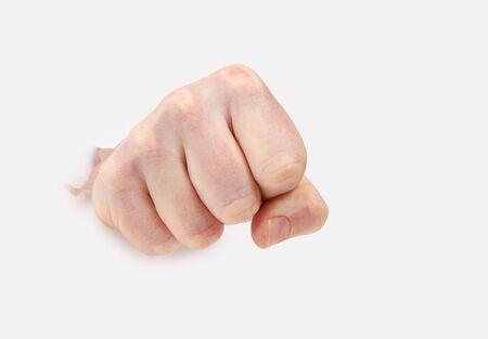 Hand punching through paper.Hand making fist Stock Photo