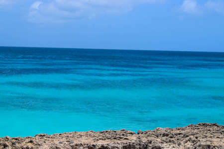Arikok Natural Park on the island of Aruba in the Caribbean Sea with deserts and ocean waves on the rocky coast Фото со стока
