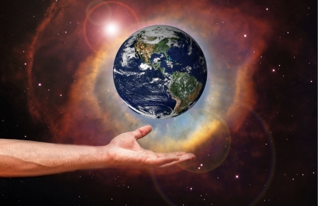 Hand holding image of the Earth photo