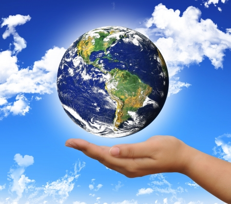 protect the world planet on the hand