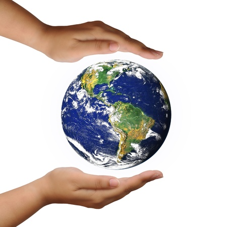 populations: protect the world planet on the hand