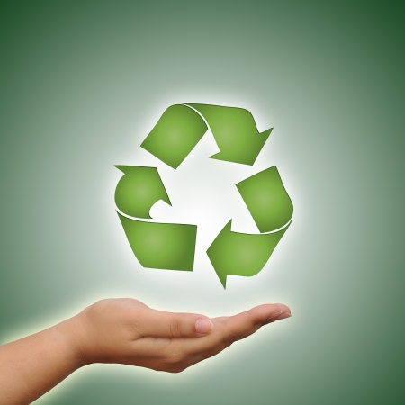 environmentalist tag: Hand holding recycle symbol on green background