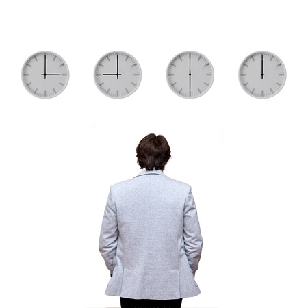 Businessman looking at clocks Stock Photo - 15880516