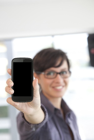 Portrait of beautiful young woman holding smartphone Stock Photo - 15930506