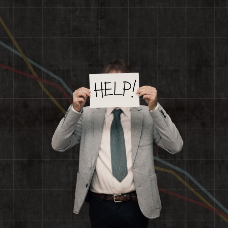 financial crisis: Business mas ask help in the economic recession  Stock Photo