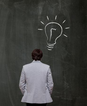 man have an idea at black board Stock Photo - 16556580