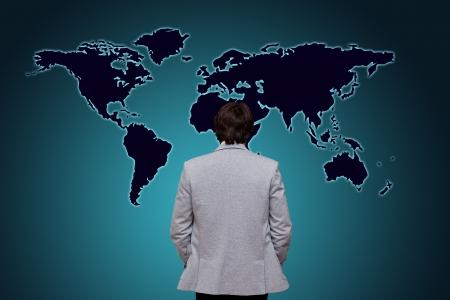 businessman watching world map photo