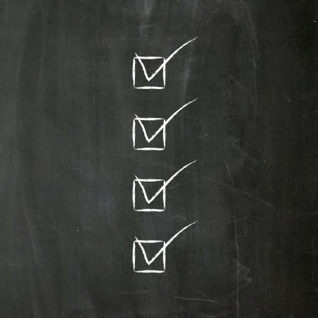 Checklist hand written on blackboard with chalk