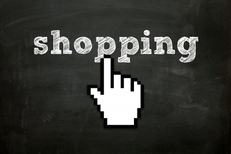 e commerce icon: custom made hand cursor clicking  shopping  text on blackboard Stock Photo