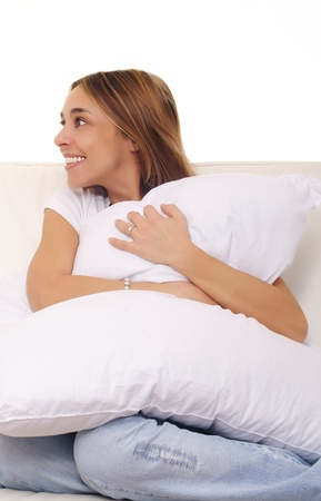 mature lady cuddling a pillow on couch Stock Photo - 17053174