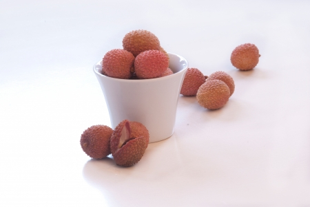lychees exotic fruit posed on wood table